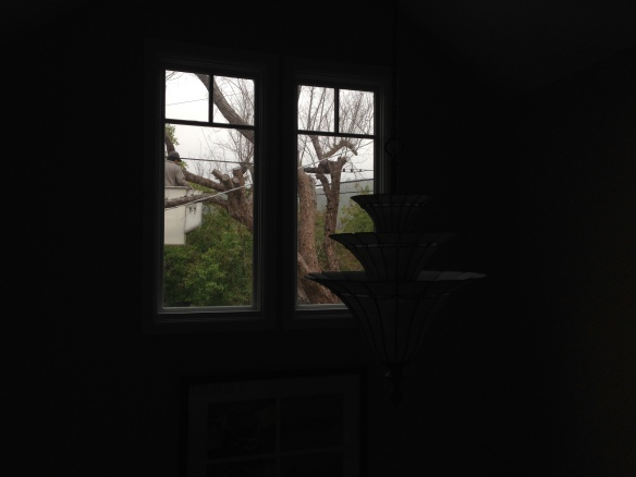 As you can see, the men are working to remove our tree.  It was always such a nice view to peer out this window and feel like you were in a tree house.